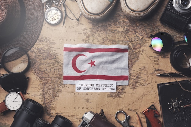 Northern cyprus flag between traveler's accessories on old vintage map. overhead shot