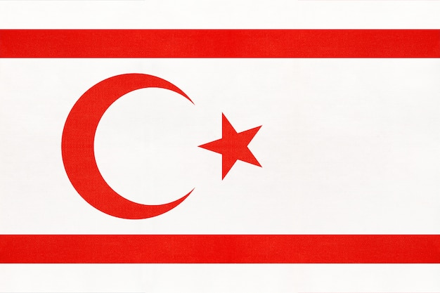 Northern cyprus national fabric flag, textile background. symbol of asian world country.
