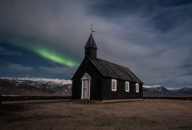 Northern lights aurora borealis black church in iceland