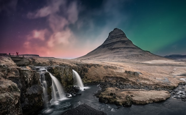 Northern lights aurora borealis over kirkjufell waterfall in iceland