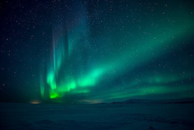 Northern lights aurora borealis over mountains