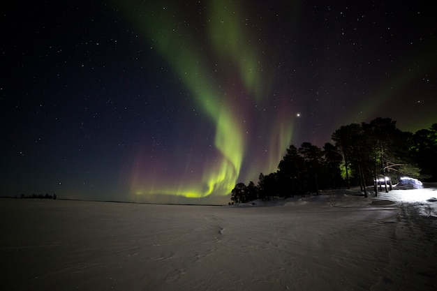 Northern lights in inari lake, lapland, finland