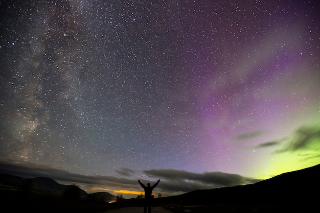Northern lights and milky way in dovrefjell national park, norway. europe