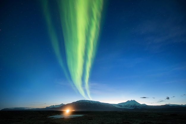 Northern lights mountain in iceland.