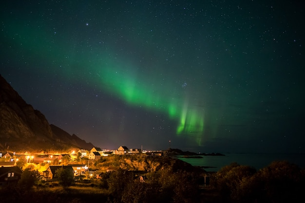 Northern lights over small village in lofoten, norway