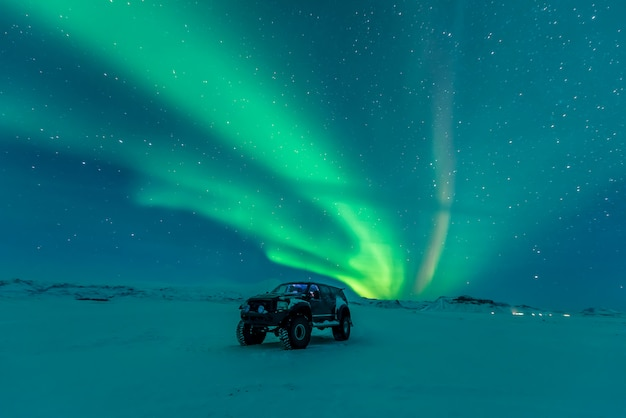 Northern lights over vehicle