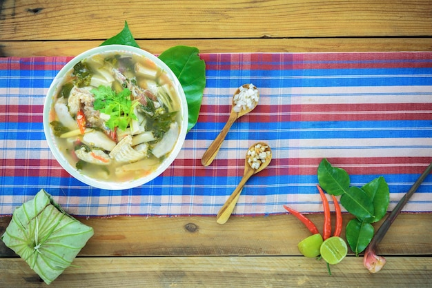 Northern style spicy chicken soup on wood background