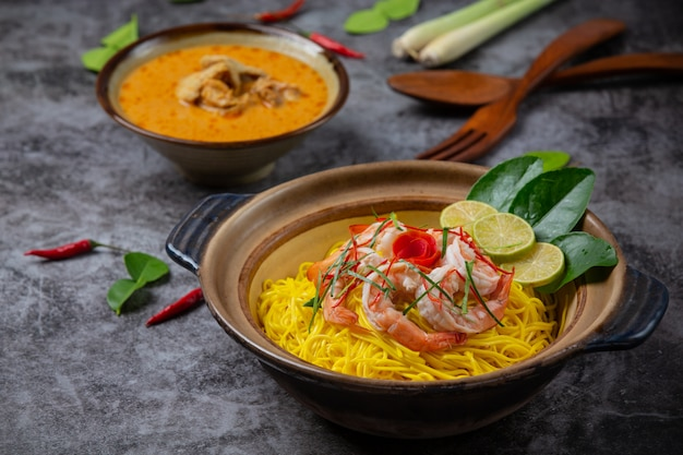 Northern thai food (khao soi shrimp), spicy noodles decorated with ingredients.