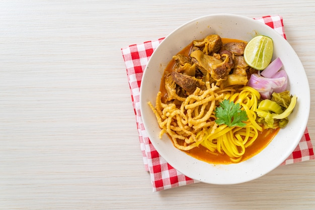 Northern thai noodle curry soup with braised pork, thai food style