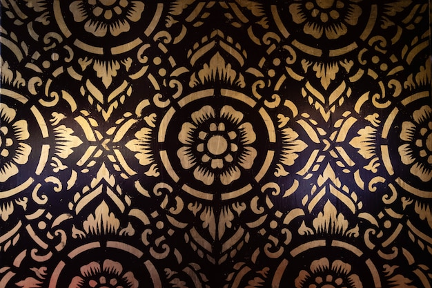 The northern thai pattern painted gilded wall pictures.