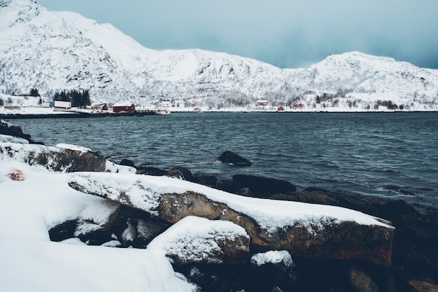 Norwegian fjord with red rorbu houses in norway in winter