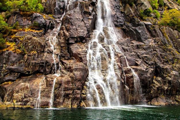 Norwegian landscape small waterfall on a rock