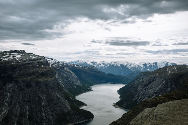 Norwegian landscape with a view of the fjord from a rock fragment troll's tongue