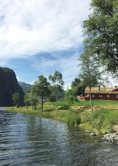 Norwegian traditional red house on the lake