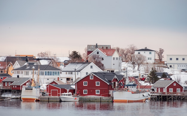 Norwegian village with fishing boat on coastline in winter
