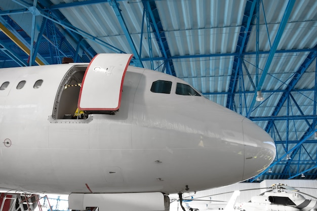 The nose of the aircraft cockpit in the maintenance hangar.