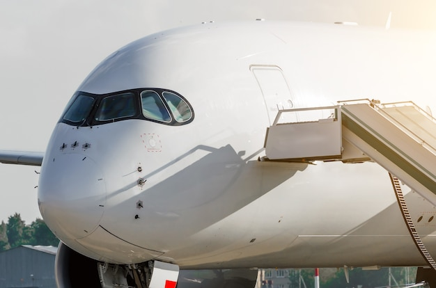 Nose of the passenger and the cockpit of the pilot, airplane close up.