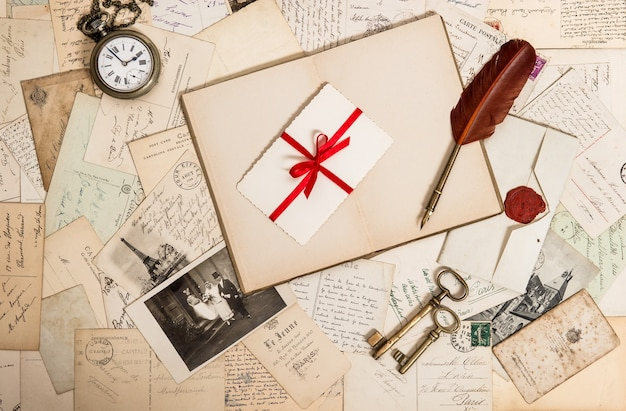Nostalgic vintage wedding honeymoon background with old photos, letters, accessories and postcards