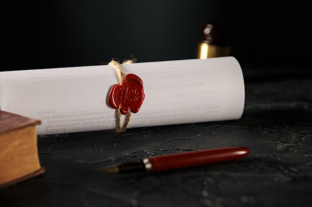 Notary and law concept. stamp with book and pen on the table. wooden gavel behind.