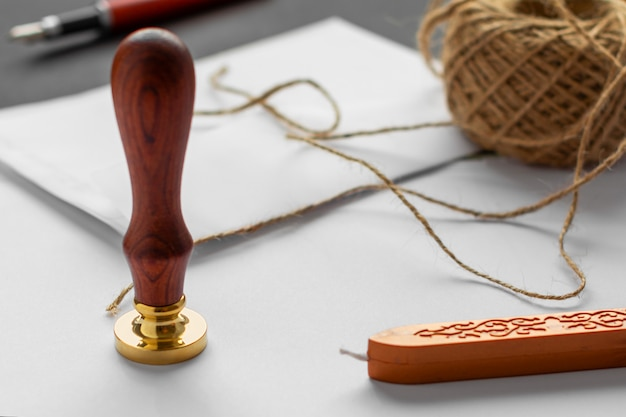 Notary public wax stamper. white envelope with brown wax seal, golden stamp.