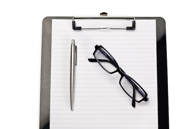 Note pad, pen and glasses on a white background