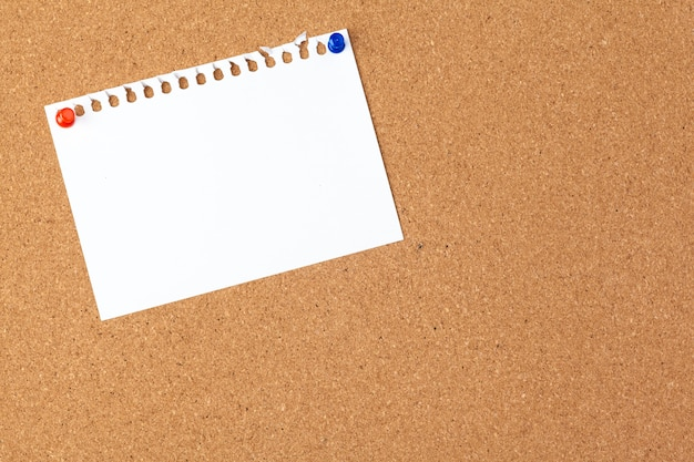 Note paper pined on brown cork board
