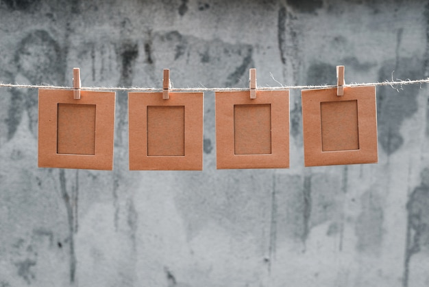 Note or picture frame on the rope and tweezers abstract background