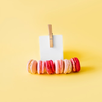 Note and pin near macaroons