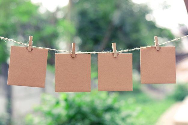 Note for text or picture on the rope and tweezers bokeh background