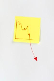 Nota con grafico economico in calo