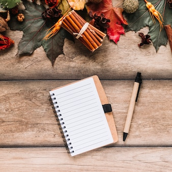 Notebook among colourful leaves