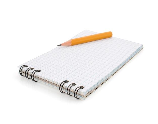 Блокнот и карандаш изолированные