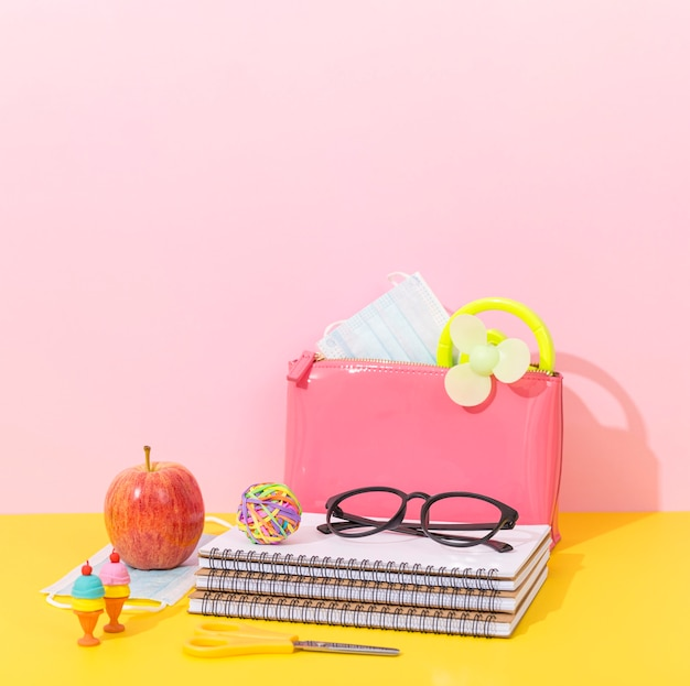 Notebook for back to school with glasses and apple