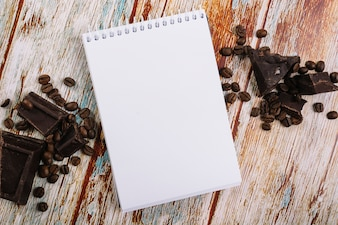 Notebook between chocolate and coffee