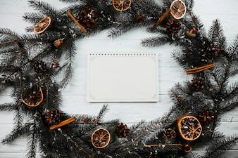 Notebook between fir branches