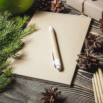Notebook in the center of christmas decoration