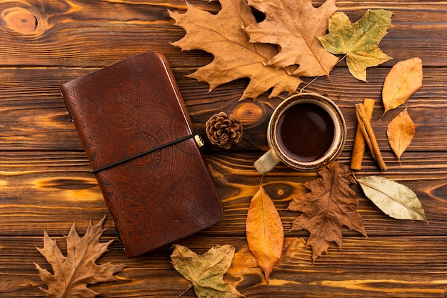 Notebook and coffee autumn composition
