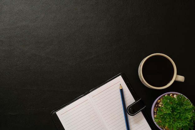 Notebook and coffee at the desk top view