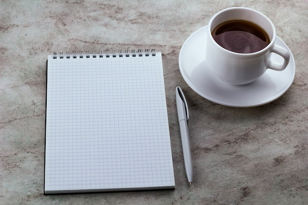 Notebook and coffee marble background
