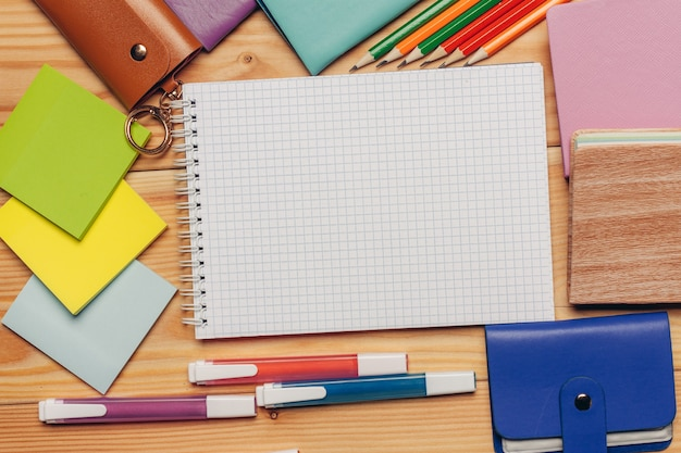 Notebook colorful paper stationery close-up work desk top view