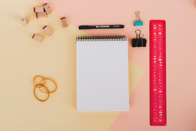 Notebook and drafting supplies composition