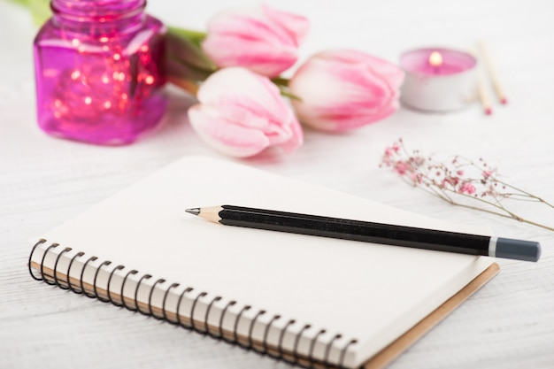 Notebook, flowers and pink lights