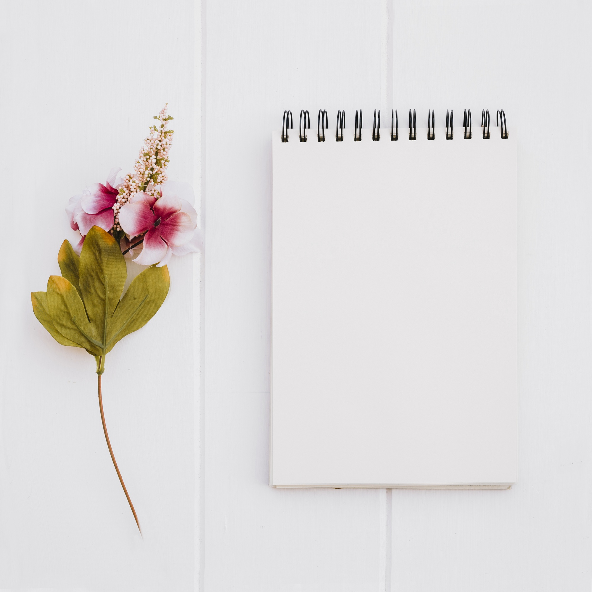 Notebook for mock up with roses on white wood background