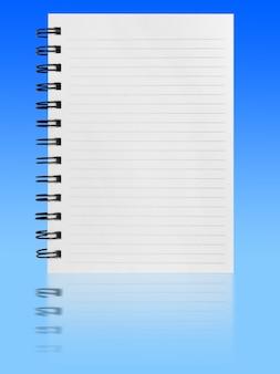 Тетрадь изолированная на голубой предпосылке