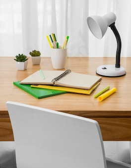 Notebook and lamp on desk