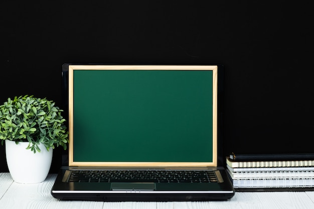 Notebook laptop computer with green chalkboard screen