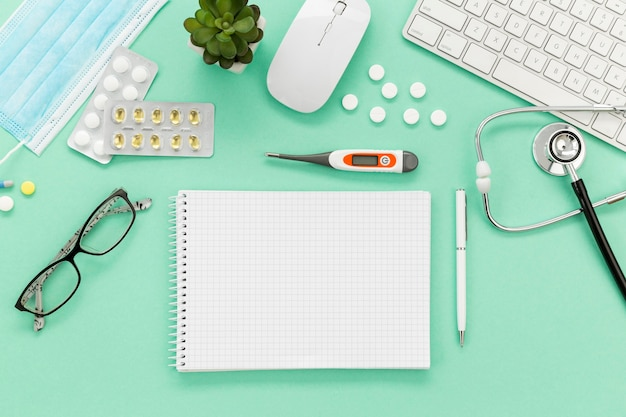 Notebook and medicine on desk