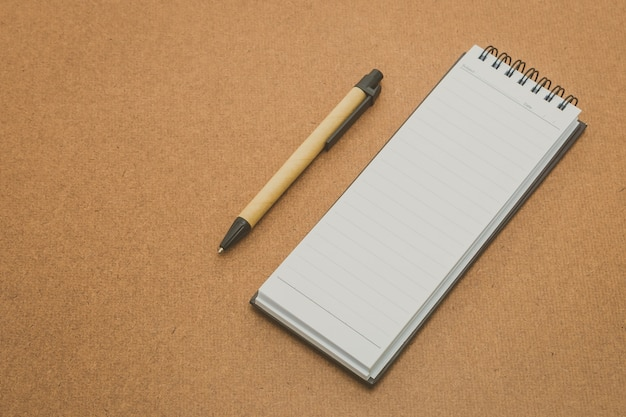 Notebook mock up on wood background