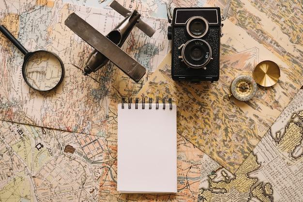 Notebook near camera and tourist stuff