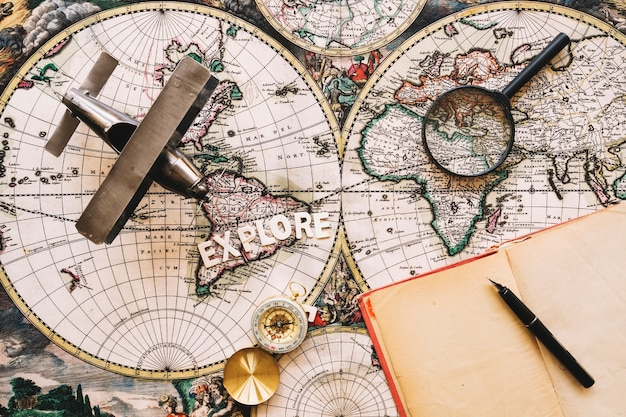 Notebook near tourist stuff and explore writing